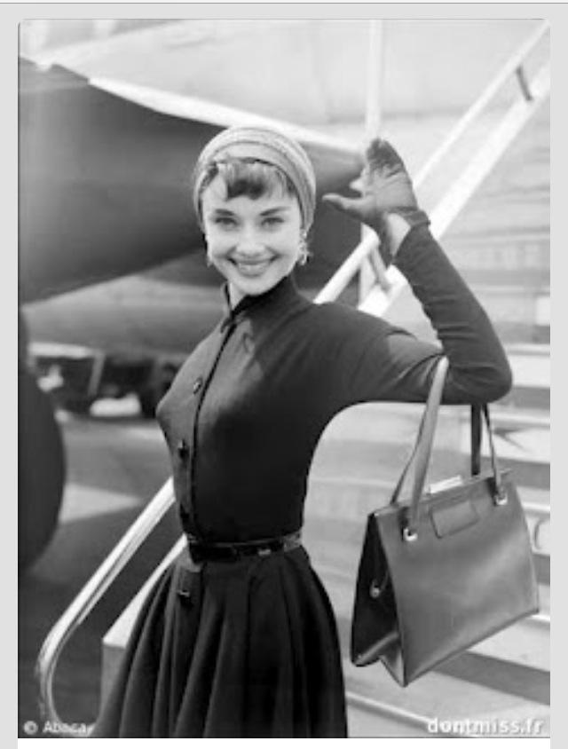 Audrey Hepburn waving